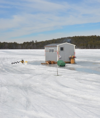 Ice Fishing hut with auger on left