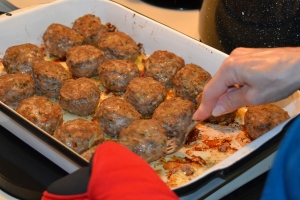 Baked meatballs gently moved to the sauce