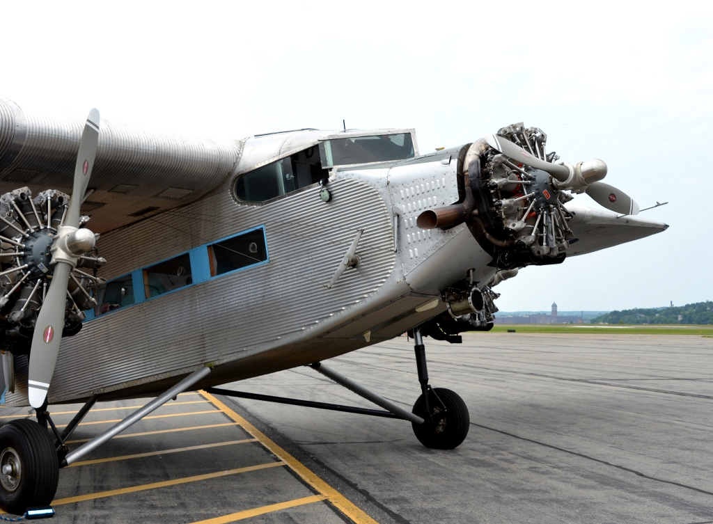 Tri-Motor plane note cables and open cockpit window