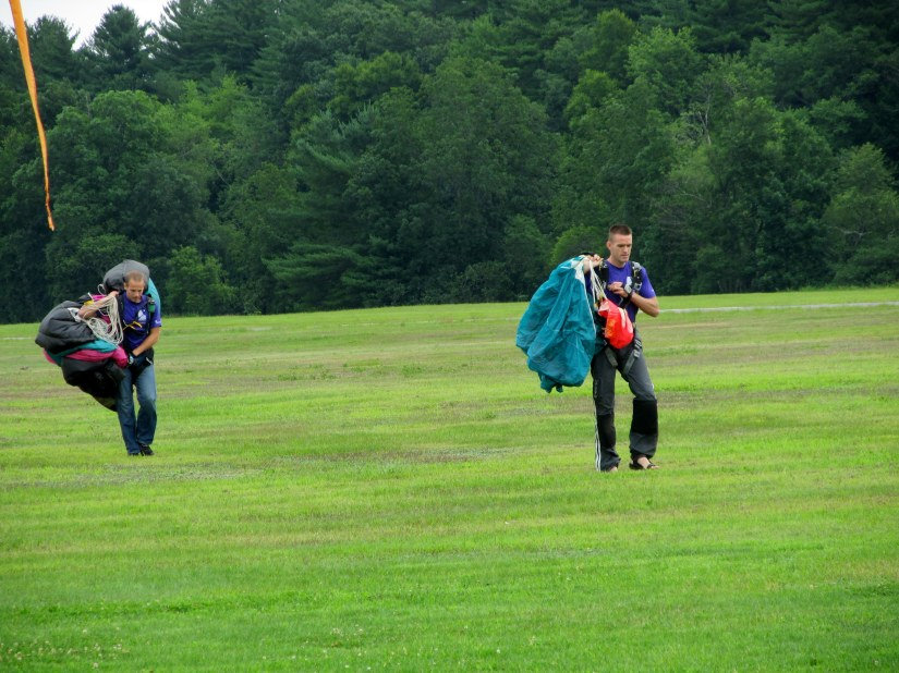After the fall - Skydivers team leaves the field after a test jump