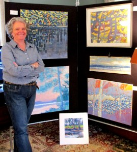 Artist Ann Trainor Domingue with some of her work