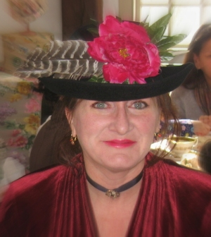 Dressed for a Victorian tea party with one major difference - Victorians mindlessly massacred to the point of extinction many birds and animals extinct for their own personal embellishment. I can assure the feathers in my hat were willingly donated by my turkey friends.