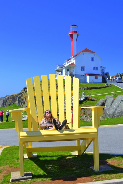 This giant yellow chair landmark at Cape Forchu was destroyed and E & J MILLWORKS  by hurricane Arthur on July 4 2014 and someone from the community volunteered to bring it back