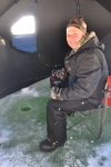 Tommy Tombarello inside the ice fishing tent