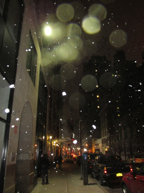 Walking back to DoubleTree west 36th Street between 8th and 9th (see flags) as snow starts to fall